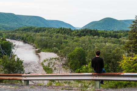 gazing: Man gazing out to the hills and mountains in Cape Breton