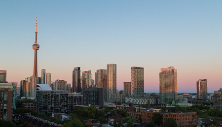building cn tower: Toronto Skyline at Sunset from the west with copy space