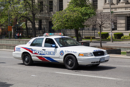 police: TORONTO, CANADA - 24TH MAY 2015: The outside of a Toronto Police Car during the day.