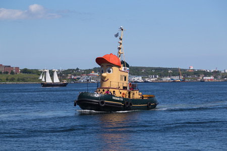 theodore: HALIFAX, CANADA - 3RD JULY 2015: The Theodore Too tugboat in the Halifax waterfront during the day. People can be seen on the boat.