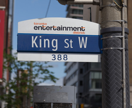 entertainment district: TORONTO, CANADA - 19TH MAY 2015: A sign for King Street West in the entertainment district of Toronto