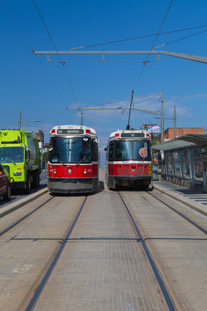 car lots: TORONTO, CANADA - 18TH JUNE 2015: Multiple streetcars along St Clair Avenue in Toronto. Editorial