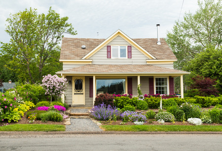 residential: BADDECK, CANADA - 5TH JULY 2015: The outside of a house in Baddeck showing the style and design