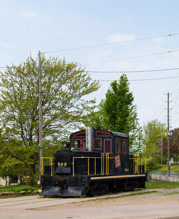 king street: GANANOQUE, CANADA - 18TH MAY 2015: A old locomotive in Gananoque along King street Editorial
