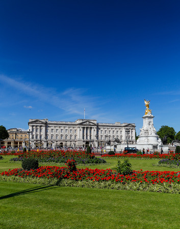queen bed: LONDON, UK - 18TH JULY 2015: The outside of Buckingham Palace in London during the summer showing the buildings and flowers. People can be seen outside. Editorial