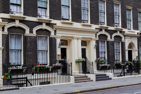 terrace house: LONDON, UK - 20TH JULY 2015: The outside of buildings along Gower Street in London during the day, showing the architecture style. Editorial
