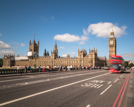 lots people: LONDON, UK - 21ST JULY 2015: Big Ben in Westminster with red London Buses. Lots of people can be seen.