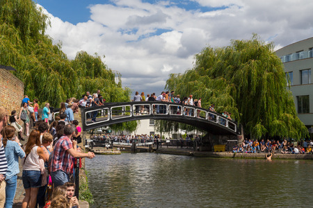 lots people: LONDON, UK - 19TH JULY 2015: A bridge in Camden Lock with lots of people on the bridge and at the side of the water. A man can be seen climbing out of the water. Editorial