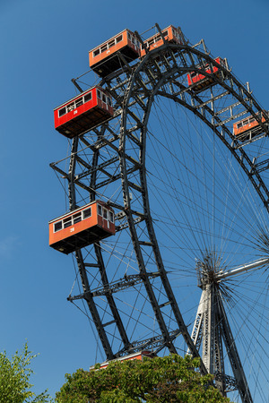 prater: VIENNA, AUSTRIA - 6TH AUGUST 2015: A view of the Wiener Riesenrad in Prater from outside the park Editorial