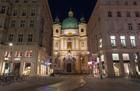 st  peter: VIENNA, AUSTRIA - 27TH JULY 2015: The outside of the Catholic Church of St. Peter in Vienna at night from the Graben