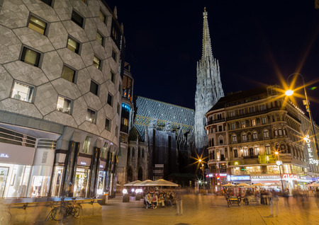 stephansplatz: VIENNA, AUSTRIA - 27TH JULY 2015: A view towards the Stephansplatz church in Vienna at night. Other buildings and people can be seen. Editorial