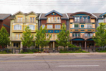 front of house: TORONTO, CANADA - 25TH JUNE 2015: Different colored houses in The Beaches area of Toronto during the day.