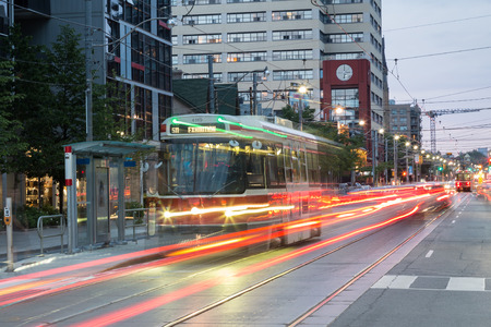 streetcar: TORONTO, CANADA - 25TH JUNE 2015: A Toronto Streetcar at night with the blur of traffic and light trails