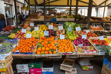 fruit market: VENICE, ITALY - 14TH MARCH 2015: Fresh fruit and vegetables at a market stall in Venice. People can be seen.
