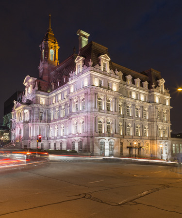montreal city: A view of Montreal City Hall (Hôtel de Ville de Montréal) at Night. The blur of traffic can be seen. There is space for text. Editorial
