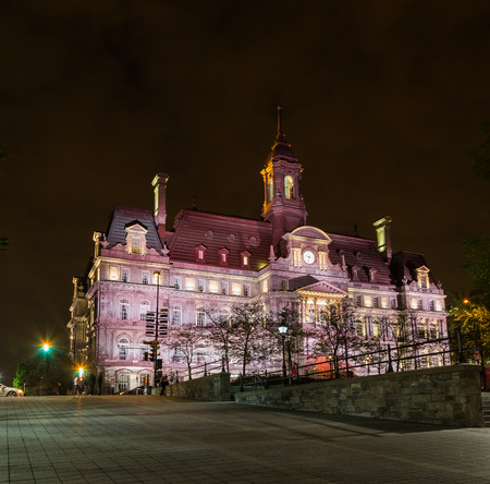 montreal city: MONTREAL, CANADA - 17TH MAY 2015: A view of Montreal City Hall (Hôtel de Ville de Montréal) at Night. People can be seen. Editorial