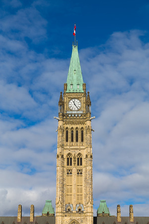 hill distant: Closeup to the Ottawa Parliament Clock Tower in Canada during the day