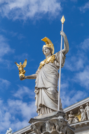 athena: The Goddess Athena statue at the top of the Pallas Athene Fountain outside the Austrian Parliament in Vienna