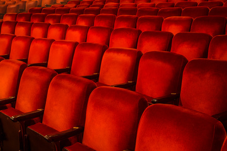 theatre: Rows of Red Chairs inside a theatre with copy space