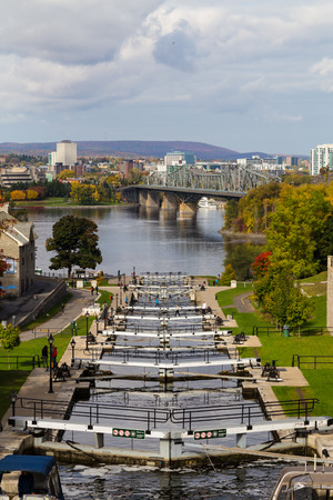 rideau canal: OTTAWA, CANADA - 12 OCTOBER 2014: Ottawa Locks along the Rideau Canal during the day. People can be seen