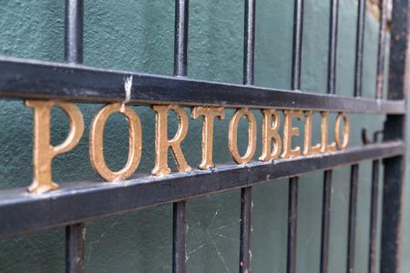 portobello: LONDON, UK - 16TH JULY 2015: The word Portobello on a fence along Portobello Road in London