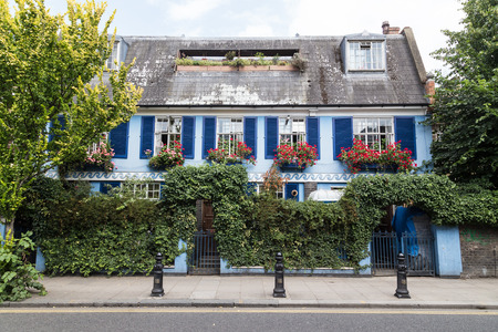 notting hill: LONDON, UK - 16TH JULY 2015: The outside of colorful buildings in Notting hill, London during the day.