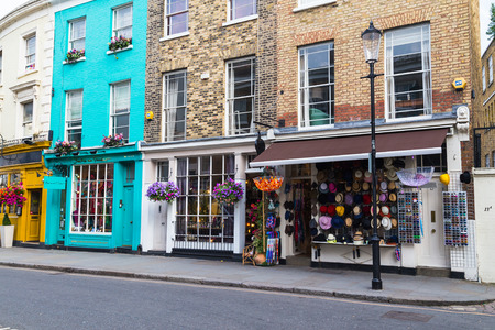 portobello: LONDON, UK - 16TH JULY 2015: The outside of shops along Portobello Road in the Nottinghill Area of London.