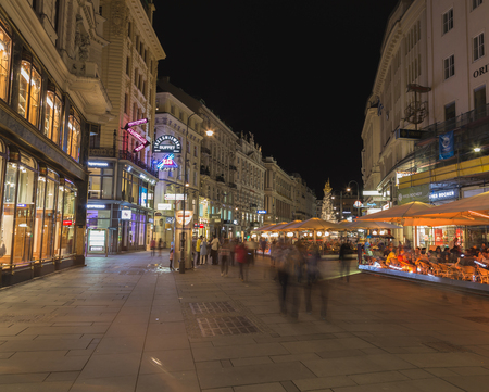 alfresco: VIENNA, AUSTRIA - 28TH JULY 2015:  A view along the Graben in Vienna at Night. The outside of buildings and the blur of people can be seen.