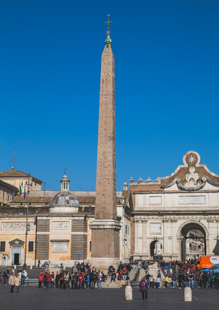heliopolis: ROME, ITALY - 12TH MARCH 2015: People at the Piazza del Popolo in central Rome. The Ramesses II from Heliopolis obelisk can be seen in the middle.