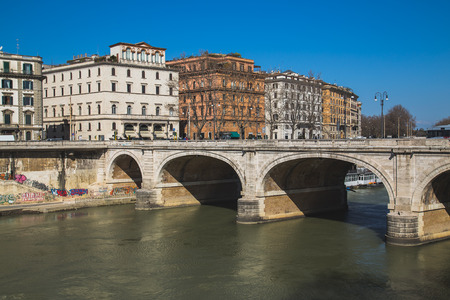 cavour: ROME, ITALY - 12TH MARCH 2015:  The Ponte Cavour Bridge in Rome on the River Tiber. Buildings can be seen. Editorial
