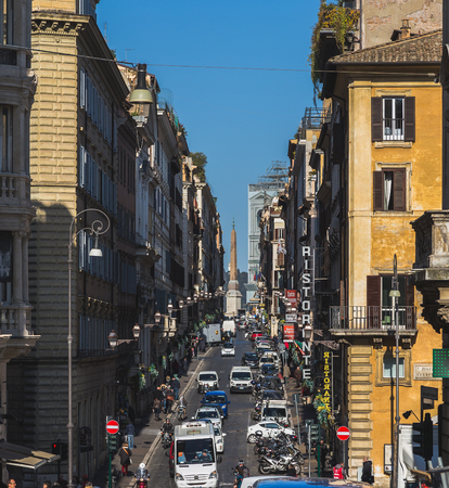 city traffic: ROME, ITALY - 12TH MARCH 2015: A view down streets in Rome, showing building exteriors, traffic and people.