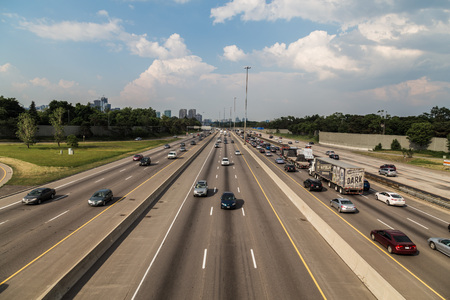highway traffic: TORONTO, CANADA - 16TH JUNE 2014: A high view of Traffic on the 401 Highway in Toronto during the day.