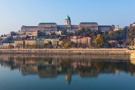 31st: BUDAPEST, HUNGARY - 31ST OCTOBER 2015: A view of the Buda Castle in Budapest from across the Danube River in the morning. Other buildings and reflections can be seen. Editorial