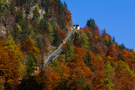car lots: HALLSTATT, AUSTRIA - 28TH OCTOBER 2015:  A view of the Gondola in Hallstatt that leads up to the lookout point. Gondolas can be seen going both ways. Editorial