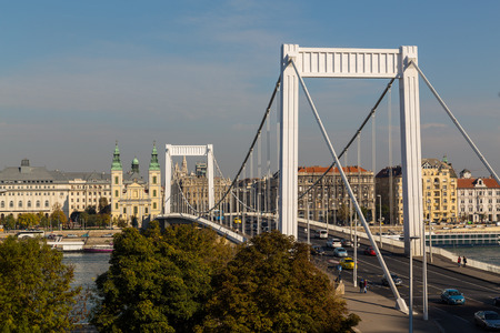 elisabeth: BUDAPEST, HUNGARY - 30TH OCTOBER 2015: A view of the Elisabeth Bridge in Budapest Hungary during the day. People and traffic can be seen.