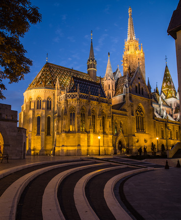 building exterior: The outside of Matthias Church in Budapest Hungary at night shownig the gothic architecture.