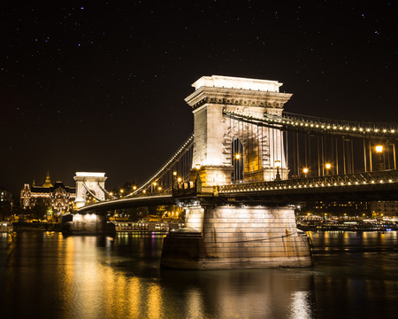 the chain bridge: The  Szechenyi Chain Bridge at night. There are stars in the sky and space for text. Stock Photo