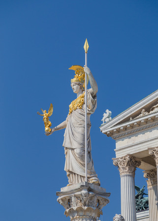 statue: The Goddess Athena statue at the top of the Pallas Athene Fountain outside the Austrian Parliament in Vienna