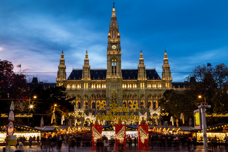 market hall: VIENNA, AUSTRIA - 15TH NOVEMBER 2015: The outside of Christmas Market at Rathaus (Vienna City Hall). The blur of people can be seen.