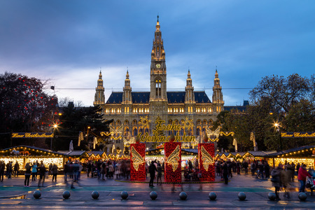 christkindlmarkt: VIENNA, AUSTRIA - 15TH NOVEMBER 2015: The outside of Christmas Market at Rathaus (Vienna City Hall). The blur of people can be seen.
