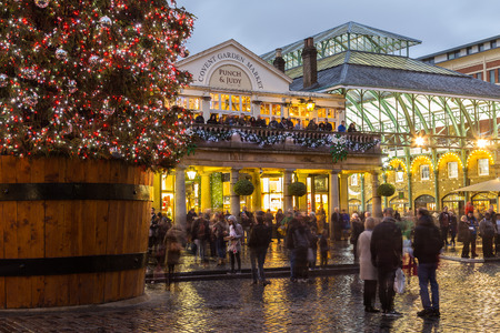 covent garden market: LONDON, UK - 27TH NOVEMBER 2015: The outside of Covent Garden at Christmas showing the tree and decorations. People can be seen.