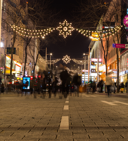christmas atmosphere: VIENNA, AUSTRIA - 4TH DECEMBER 2015: A view along Mariahilferstrasse at night showing the Christmas atmosphere. Lots of people can be seen.