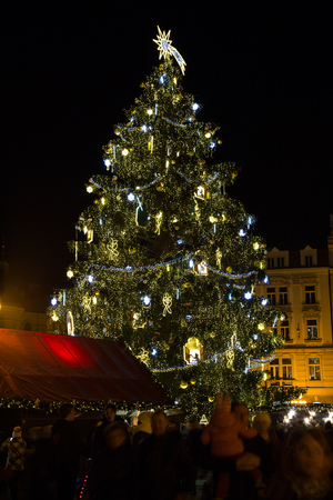 christmas tree decoration: PRAGUE, CZECH REPUBLIC - 6TH DECEMBER 2015: The Christmas Tree at Old Town Square in Prague during the festive season. People can be seen.