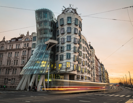 dancing house: PRAGUE, CZECH REPUBLIC - 5TH DECEMBER 2015: The outside of the Dancing House (Fred and Ginder) building during the day. The blur of traffic can be seen going past.