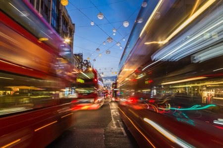 double decker: LONDON, UK - 23RD DECEMBER 2015: Busy Traffic down Oxford Circus in London during the Christmas Season. Double Decker Buses can be seen.