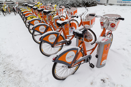 parked bikes: VIENNA, AUSTRIA - 5TH JANUARY 2016: Vienna public bikes parked up at their docks during the winter months and covered in snow.
