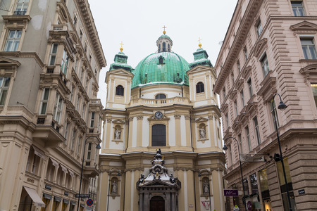 st  peter: VIENNA, AUSTRIA - 5TH JANUARY 2016: The outside of the Catholic Church of St. Peter in Vienna from the Graben during the winter. Snow can be seen.