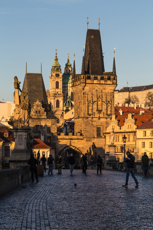 morning blue hour: PRAGUE, CZECH REPUBLIC - 6TH DECEMBER 2015: A view along Charles Bridge in Prague towards the Lesser Quarter in the morning. Lots of people can be seen. Editorial