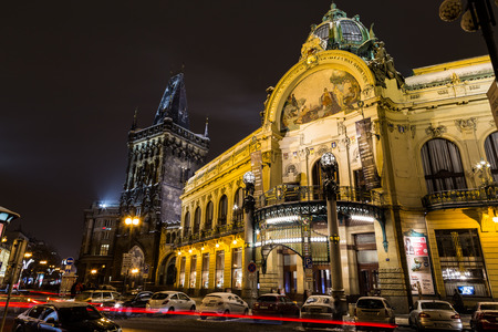 seperation: PRAGUE, CZECH REPUBLIC - 6TH JANUARY 2016: The Powder Tower and Municipal House in Prague at Night in the Winter. Cars and Traffic can be seen.