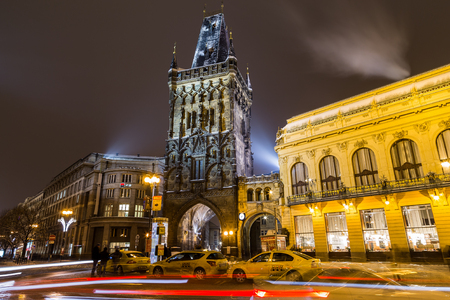 seperation: PRAGUE, CZECH REPUBLIC - 6TH JANUARY 2016: The Powder Tower in Prague at Night in the Winter. Cars, people and Traffic can be seen.